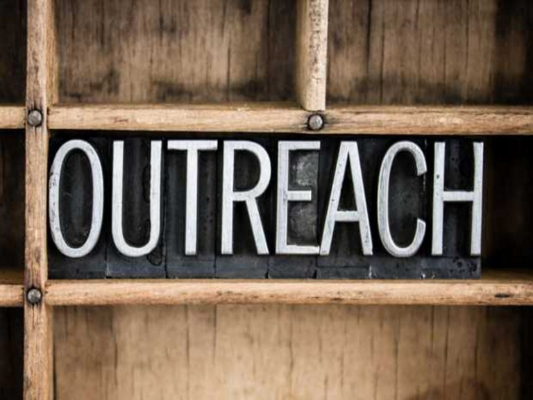 outreach-sign-carved-in-wood